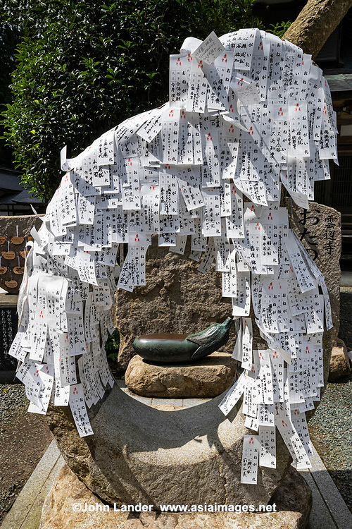 Omikuji Wish Papers at Unpenji - Temple No. 66 on the Shikoku Pilgrimage. Although counted as being in Kagawa Prefecture, it's actually just across the prefectural border in Tokushima. Located at an elevation of 911 metres, it is the highest temple on thepilgrimage andit's one the nansho or 'difficult places' that test the will of pilgrims although the cable car that starts in Kagawa makes it much easier to get up to the top now. In the temple grounds are masses of stone rakan statues of followers of the Buddha. There are also other statues of Kannon and Fudo, which are both National Treasures.  The temple was founded by Kukai in his youth and was dedicated by Emperor Kameyama who planted a gingko tree in the grounds.  At one time in its heyday the temple had seven shrines, twelve affiliated halls, and eight branch temples.