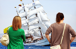 """© Licensed to London News Pictures. 05/09/2014<br /> Two women looking at """"Guayas in the parade of sail""""  BY John Cadd at the <br /> Ships Shades Photography Exhibition at Old Royal Naval College,Greenwich.<br /> The Tall Ships festival 2014  starts today, marking the beginning of a week-long festival filled with wonderful displays on the River Thames at Greenwich.<br /> <br /> (Byline:Grant Falvey/LNP)"""
