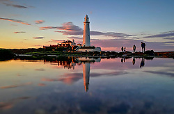 © Licensed to London News Pictures. 07/06/2019. Whitley Bay, UK. Sunset at St. Mary's Lighthouse at Whitley Bay in North Tynemouth, reflected in the sea on a clear and bright evening on the north east coast. Photo credit: Colin Scarr/LNP