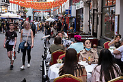 With many people and families staying in the UK for their Summer break during the school holidays, a large number of domestic tourists, who may normally have been travelling abroad, have decended on the capital to see the sights, as seen here in Chinatown on 10th August 2021 in London, United Kingdom. Following the Coronavirus / Covid-19 health scare of the last two years, and with some travel restrictions still in place, more people have chosen a staycation which is a holiday spent in ones home country rather than abroad, or one spent at home and involving day trips to local attractions.