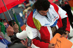 """Alberto Tomba signing the autograph to his Italian fans after the second run of """"Ski Legends HIT Challenge by Jure Kosir"""" event in Kranjska Gora, Slovenia, on February 2, 2008. (Photo by Vid Ponikvar / Sportal Images)."""