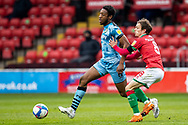 Forest Green Rovers Ebou Adams(8) battles for possession with Liam Kinsella of Walsall  during the EFL Sky Bet League 2 match between Walsall and Forest Green Rovers at the Banks's Stadium, Walsall, England on 10 April 2021.