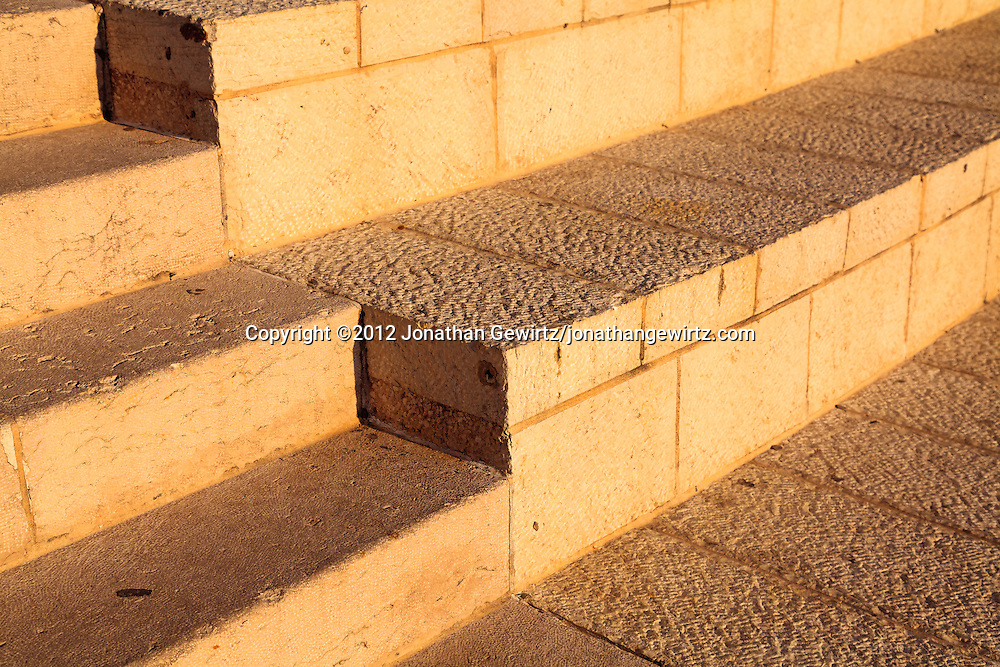 Warm afternoon light illuminates steps made from Jerusalem stone. WATERMARKS WILL NOT APPEAR ON PRINTS OR LICENSED IMAGES.