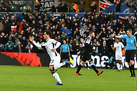 Football - 2019 / 2020 Sky Bet (EFL) Championship - Swansea City vs. Derby County<br /> <br /> Yan Dhanda of Swansea City celebrates scoring his team's first goal, as Wayne Rooney of Derby County remonstrates with referee Mr Mathew Donohue in the background at The Liberty Stadium.<br /> <br /> COLORSPORT/WINSTON BYNORTH