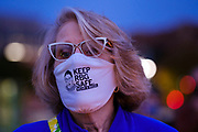 20 SEPTEMBER 2020 - DES MOINES, IOWA: A woman wearing her COVID face mask at a vigil for US Supreme Court Justice Ruth Bader Ginsburg in Poppajohn Sculpture Park in Des Moines. About 200 people attended the candlelight vigil for Justice Ruth Bader Ginsburg. Ginsburg died from pancreatic cancer on September 18, 2020.       PHOTO BY JACK KURTZ