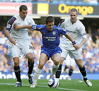 Photo: Lee Earle.<br /> Chelsea v Bolton Wanderers. The Barclays Premiership.<br /> 15/10/2005. Chelsea's Cole battles his way past Tal Ben Haim (L) and kevin Nolan.