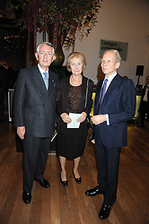 Left to right, the Greek Ambassador to the UK IOANNIS BOURLOYANNIS-TSANGARIDIS, MRS BOURLOYANNIS-TSANGARIDIS and MARINOS YEROULANOS at the opening of the Royal Academy of Arts Byzantium 330-1453 exhibition held at the RA, Burlington House, Piccadilly, London on 21st October 2008.