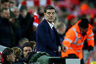 West Ham United Manager Slaven Bilic  looks on from the dugout. Premier League match, Liverpool v West Ham Utd at the Anfield stadium in Liverpool, Merseyside on Sunday 11th December 2016.<br /> pic by Chris Stading, Andrew Orchard sports photography.