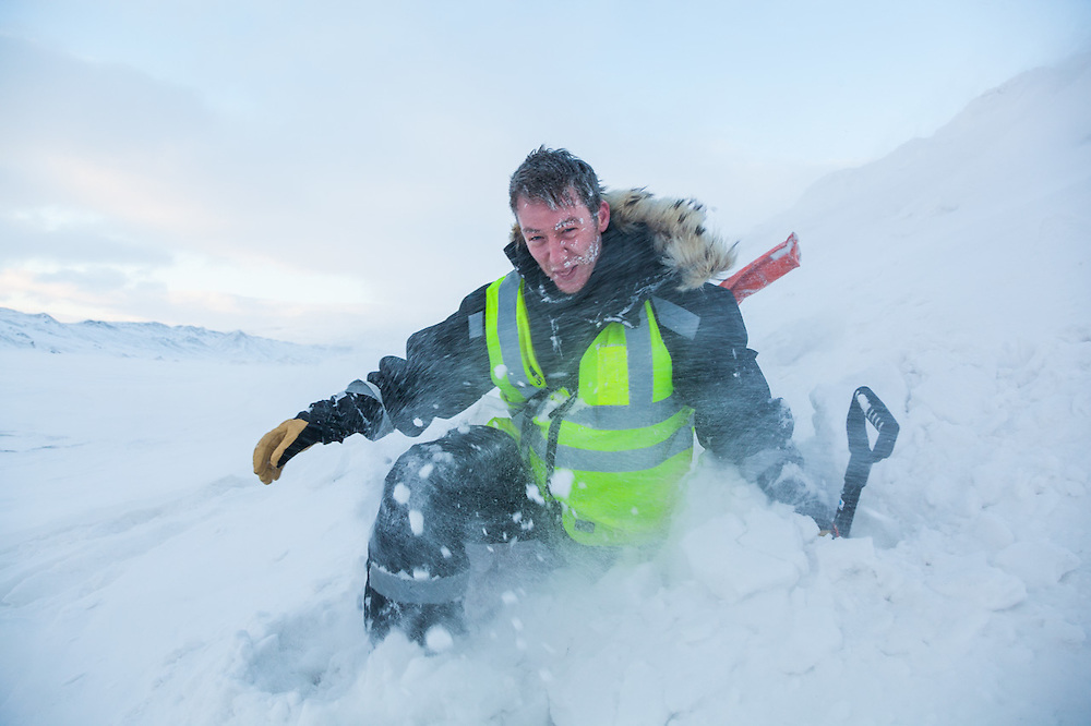 UNIS student Stephen Jennings emerges from the deep snow on a class field trip to Rabotbreen, Svalbard.