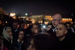 18 April 2019, Jerusalem: Father Bernard leads a moment of prayer as on Maundy Thursday (Western tradition), the Church of Gethsemane filled to the brim with Christians from Jerusalem and all over the world participating in the Easter celebrations, who then lit candles, marching through the valley below, and up the hillside to share a moment of prayer.