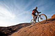 One man mountain biking Slickrock trail near Moab, Utah.