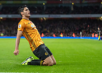 Football - 2019 / 2020 Premier League - Arsenal vs. Wolverhampton Wanderers<br /> <br /> Raul Jimenez (Wolverhampton Wanderers) sildes on his knees after he scores his teams equaliser at The Emirates Stadium.<br /> <br /> COLORSPORT/DANIEL BEARHAM