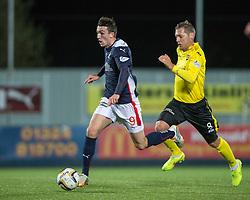 Falkirk's David Smith and  Livingston Burton O'Brien.<br /> Falkirk 0 v 0  Livingston, Scottish Championship game played 21/10/2014 at The Falkirk Stadium.