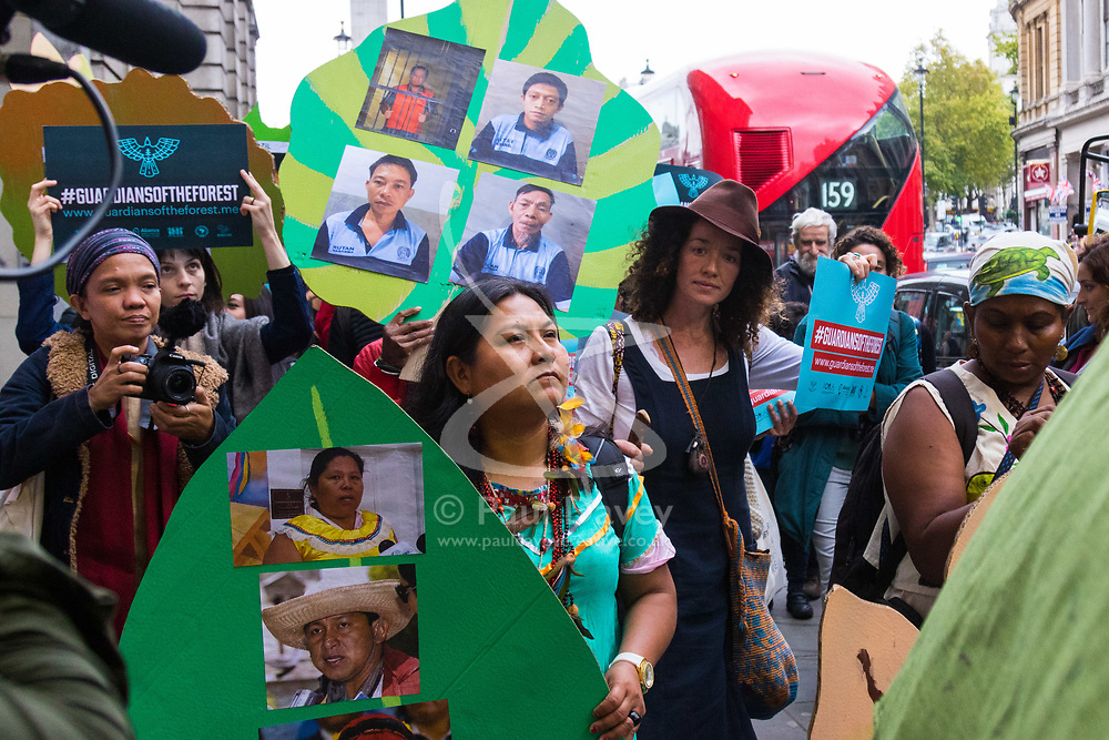 London, October 24 2017. People from various ethnic groups under the banner of Guardians of the Forest march through London to Parliament Square in protest against the killing of 'forest people' by illegal loggers. © Paul Davey
