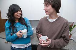 Teenagers having a cup of tea,
