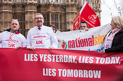 © Licensed to London News Pictures. 06/03/2019. LONDON, UK.  Len McCluskey (2L), General Secretary of Unite, joins workers from Honda's Swindon plant during a demonstration outside the Houses of Parliament calling on MPs to save their factory from closing.  Honda recently announced that the plant will cease production in 2022 amidst uncertainty over the future post-Brexit.  Photo credit: Stephen Chung/LNP