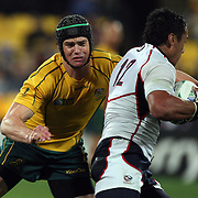 Berrick Barnes, Australia, tackles Junior Sifa, USA, during the Australia V USA, Pool C match during the IRB Rugby World Cup tournament. Wellington Stadium, Wellington, New Zealand, 23rd September 2011. Photo Tim Clayton...
