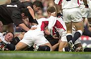 Twickenham. Surrey. UK England vs New Zealand, Autumn Internationals.<br /> Inthe Ruck, Jonny WILKINSON ,Steve THOMPSON, Taine Randell,<br /> 09/11/2002<br /> International Rugby England vs New Zealand [Mandatory Credit Peter SPURRIER/Intersport Images]