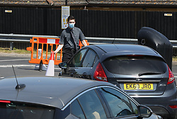 © Licensed to London News Pictures. 20/05/2020. Gillingham, UK. Queues build up at a McDonald's Drive Through restaurant in Gillingham, Kent. A small number of Drive Through only branches are opening today. The government has announced a series of measures to slowly ease lockdown, which was introduced to fight the spread of the COVID-19 strain of coronavirus. Photo credit: Peter Macdiarmid/LNP