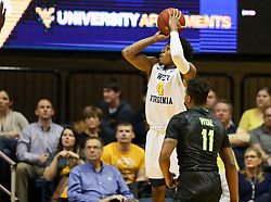 Jan 9, 2018; Morgantown, WV, USA; West Virginia Mountaineers guard Daxter Miles Jr. (4) shoots a jumper during the first half against the Baylor Bears at WVU Coliseum. Mandatory Credit: Ben Queen-USA TODAY Sports