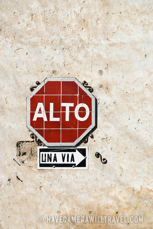 A stop sign attached to a wall in Antigua Guatemala. Famous for its well-preserved Spanish baroque architecture as well as a number of ruins from earthquakes, Antigua Guatemala is a UNESCO World Heritage Site and former capital of Guatemala.