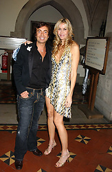 JULIEN MACDONALD and MELISSA ODABASH at Andy & Patti Wong's annual Chinese New Year party, this year celebrating the year of the dog held at The Royal Courts of Justice, The Strand, London WC2 on 28th January 2006.<br />