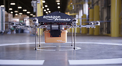 Amazon announces delivery by DRONE: Online retailer claims airborne robots will bring packages to your door in 30 minutes ..Amazon has unveiled its secret research project which it claims will be the future of home delivery - packages delivered by drones...The Internet shopping giantÕs chief executive Jeff Bezos says that he wants to use octocoptors to replace postmen and cut delivery times to just 30 minutes...Customers would have their order dropped onto their front lawn by the machine which would fly through the air from a nearby warehouse with it clasped in a metal grabber...It is not clear if the drones are a PR stunt or a serious proposition, but speaking to US TV network CBS, Bezos said: ÔI know this looks like science fiction. ItÕs not.Õ..BezosÕ claims raise the prospect of a future where drones whiz across the sky all the time ferrying post around - and perhaps one day even letters too. ..In the interview Bezos said that the drones would be able to carry goods up to five pounds in weight, which covers 86 per cent of the items that the company delivers...Bezos said that he wants to launch the ÔAmazon Prime AirÕ service within four to five years, though that will almost certainly be in the US before anywhere else...He said: ÔThese generations of vehicles, it could be a ten-mile radius from a fulfillment (delivery) center...ÔSo, in urban areas, you could actually cover very significant portions of the population...ÔAnd so, it wonÕt work for everything; you know, weÕre not gonna deliver kayaks or table saws this way. These are electric motors, so this is all electric; itÕs very green, itÕs better than driving trucks around. This is all an R&D projectÕ...Bezos said that the octocoptors would be autonomous so would not need a pilot to guide them...Instead they would use GPS tracking to find their way to and from the address...Bezos said: The hard part here is putting in all the redundancy, all the reliab