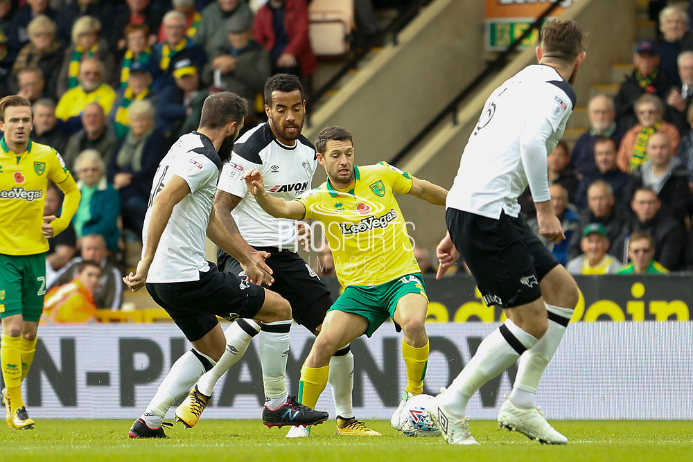 Norwich City midfielder Wesley Hoolahan (14) battles for possession with Derby County midfielder Tom Huddlestone (44) & Joe Ledley during the EFL Sky Bet Championship match between Norwich City and Derby County at Carrow Road, Norwich, England on 28 October 2017. Photo by Phil Chaplin.