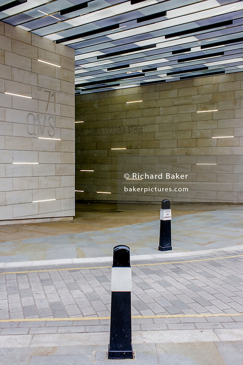 Modernist architecture at the entrance of 71 Queen Victoria Street on the corner with Trinity Lane EC4 in the City of London.