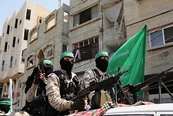 July 21, 2017 - Khan Younis, Gaza Strip - Palestinian Hamas militants take part in a protest against Israel's new security measures at the entrance to the al-Aqsa mosque compound, which include metal detectors and cameras, in Khan Younis in the the southern Gaza strip.  (Credit Image: © Ashraf Amra/APA Images via ZUMA Wire)