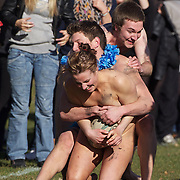 Rachel Scott, 21, is tackled during the 'Nude Blacks' versus a Fijian invitation side played at Logan Park, Dunedin as an unofficial curtain raiser match before the New Zealand V Fiji test match in Dunedin, New Zealand...The 'Nude Blacks' won the match 20-10 with 21 year old female player Rachel Scott, a member of the Otago women's rugby team named player of the day. .Over 500 people turned up to watch the match which included a blind referee, Julie Woods and three clothed streakers who were ejected from the playing area..The 'Nude Blacks' traditionally play games before test matches in Dunedin and were using this match as a warm up for three nude games planned during the IRB Rugby World Cup in New Zealand with teams from Argentina, Italy, England and Ireland involved.  Matches will be played before World Cup games in Dunedin. New Zealand. 22nd July 2011. Photo Tim Clayton