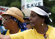 """Sharon Taylor and Barabara Washington with members of the Coalition against Death Alley and supporters  protest in front of the Governors Mansion in Baton Rouge Louisiana on the third day of a five day march through Louisiana's 'Cancer Alley' held by the Coalition Against Death Alley after being denied permits to march over river crossings. The Coalition Against Death Alley (CADA), is a group of Louisiana-based residents and members of various local and state organizations, is calling for a stop to the construction of new petrochemical plants and the passing of stricter regulations on existing industry in the area that include the groups RISE St. James, Justice and Beyond, the Louisiana Bucket Brigade, 350 New Orleans, and the Concerned Citizens of St. John  Louisiana's Cancer Alley, an 80-mile stretch along the Mississippi River, is also known as the """"Petrochemical Corridor,"""" where there are over 100 petrochemical plants and refineries ."""
