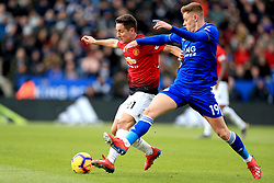 Manchester United's Ander Herrera (left) and Leicester City's Harvey Barnes battle for the ball during the Premier League match at the King Power Stadium, Leicester.