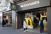 McDonalds, while now closed as a sit down fast food restaurant, is still open for take away orders on Oxford Street, Londons main shopping and retail area normally full of thousands of shoppers and traffic is virtually deserted due to the Coronavirus outbreak on 23rd March 2020 in London, England, United Kingdom. Following government advice most shoppers are staying at home leaving the streets quiet, empty and eerie. Coronavirus or Covid-19 is a new respiratory illness that has not previously been seen in humans. While much or Europe has been placed into lockdown, the UK government has announced more stringent rules as part of their long term strategy, and in particular social distancing.