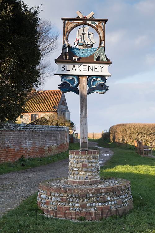 Old traditional village sign in typical quaint Norfolk village, Blakeney, UK