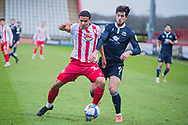 Stevenage defender Luther James-Wildin (2) battles to keep the ball as Morecambe forward Cole Stockton (9) fights to win it back during the EFL Sky Bet League 2 match between Stevenage and Morecambe at the Lamex Stadium, Stevenage, England on 6 February 2021.