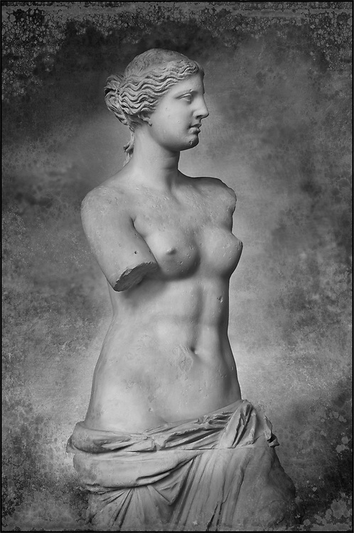 The Venus de Milo  an ancient Greek sculpture from the Hellenistic period, depicting a Greek goddess, Louvre Museum, Paris.  Wall art print by Photographer Paul E Williams .  Sculpted sometime between 150 and 125 BC, the work was originally attributed to the sculptor Praxiteles, but, based upon an inscription on its plinth, the statue is now widely agreed to be the work of Alexandros of Antioch. The statue is believed to depict Aphrodite, the Greek goddess of love and beauty, and it bears the name of Venus, the Roman counterpart of Aphrodite. Some scholars theorize that the statue actually represents the sea-goddess Amphitrite, who was venerated on Milos. Black and White Wall art print by Photographer Paul E Williams .<br /> <br /> If you prefer visit our World Gallery Print Shop To buy a selection of our prints and framed prints desptached  with a 30-day money-back guarantee and is dispatched from 16 high quality photo art printers based around the world. ( not all photos in this archive are available in this shop) https://funkystock.photoshelter.com/p/world-print-gallery<br /> <br /> Visit our HISTORIC WALL ART PRINT COLLECTIONS for more photo prints https://funkystock.photoshelter.com/gallery-collection/Historic-Antiquities-Photo-Wall-Art-Prints-by-Photographer-Paul-E-Williams/C00002uapXzaCx7Y<br /> <br /> Visit our Museum ART & ANTIQUITIES COLLECTIONS to browse more photo at: https://funkystock.photoshelter.com/p/museum-antiquities Visit our World Gallery Print Shop To buy a selection of our prints and framed prints desptached  with a 30-day money-back guarantee and is dispatched from 16 high quality photo art printers based around the world.