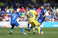 AFC Wimbledon midfielder Anthony Wordsworth (40) battles for possession with Bristol Rovers midfielder Abu Ogogo (25) during the EFL Sky Bet League 1 match between AFC Wimbledon and Bristol Rovers at the Cherry Red Records Stadium, Kingston, England on 19 April 2019.