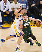Utah Jazz forward Gordon Hayward (20) drives to the basket against Golden State Warriors guard Klay Thompson (11) during Game 1 of the Western Conference Semifinals at Oracle Arena in Oakland, Calif., on May 2, 2017. (Stan Olszewski/Special to S.F. Examiner)