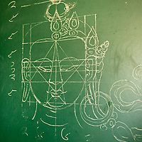 Asia, Bhutan, Thimpu. Tangkha pattern on chalkboard at the National Institute for Zorig Chusum, or traditional arts and crafts.