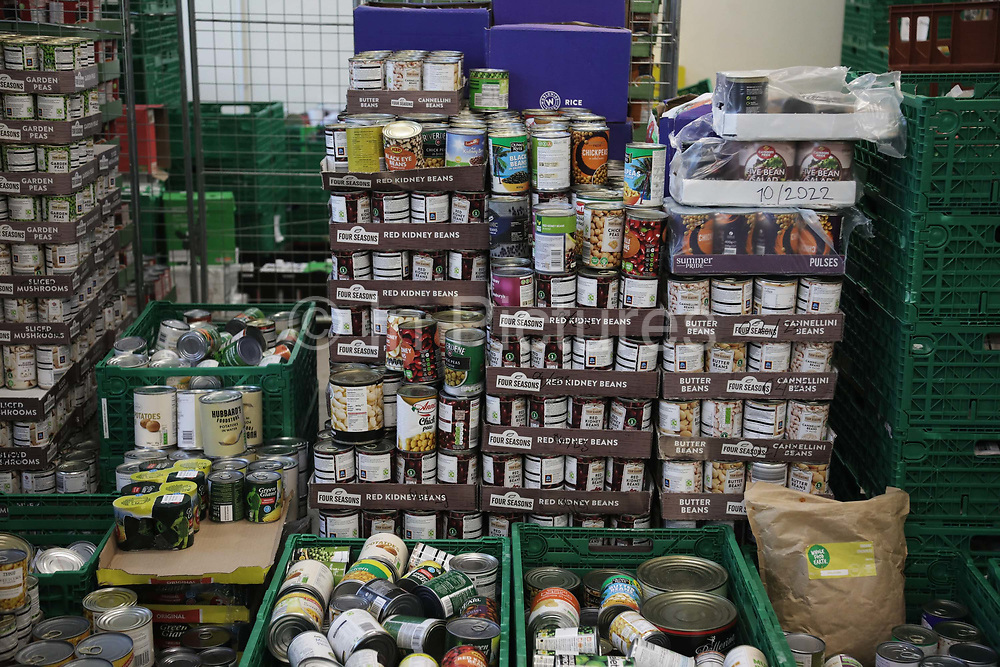 Workers and volunteers at Hackney Foodbank receive and organize food donations, 15th of December 2021, Hackney, East London, United Kingdom. Food ready to be distributed into food parcels. The Hackney Food Bank is part of a nationwide network of foodbanks, supported by The Trussell Trust, working to combat poverty and hunger across the UK. The food bank gives out three days emergency food supplies to families and individual who go hungry in the borrough. The food is all donated by individuals and the food donated is held in a small ware house where it is  sorted and packed for distribution.  More people than ever in Britain have turned to the food bank for help and in Hackney the need has gone up with 350% over the past two years.