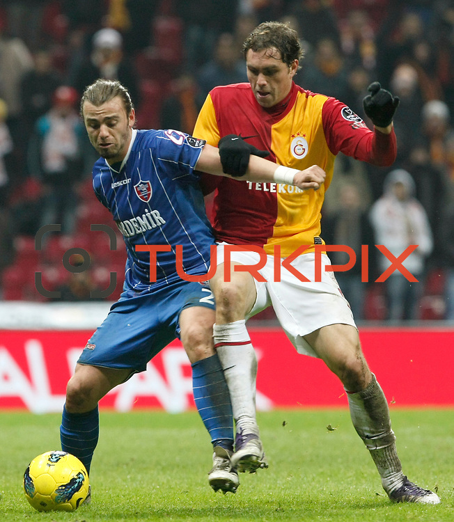 Galatasaray's Johan Elmander (R) during their Turkish Super League soccer match Galatasaray between Kardemir Karabukspor at the Turk Telekom Arena at Seyrantepe in Istanbul Turkey on Saturday 14 January 2012. Photo by TURKPIX