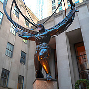 Atlas statue wears a face mask during the Coronavirus (Covid-19) outbreak in Manhattan,New York on Sunday, December 6, 2020. (Alex Menendez via AP)