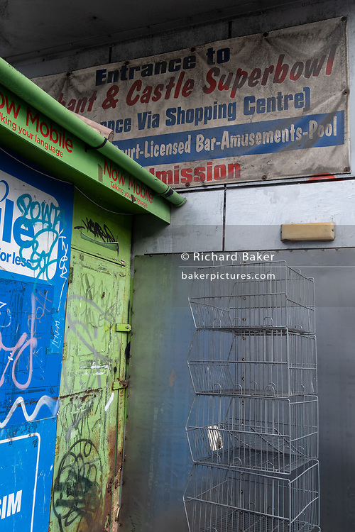On the day that Elephant & Castle Shopping Centre closes before its demolition and redevelopment, market stallholders clear away their pitches before gates are locked for the final time after 55 years, on 24th September 2020, in south London, England. The much-criticised architecture of the Elephant & Castle Shopping Centre was opened in 1965, built on the bomb damaged site of the former Elephant & Castle Estate, originally constructed in 1898. The centre was home to restaurants, clothing retailers, fast food businesses and clubs where south Londoners socialised and met lifelong partners.