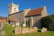 Village parish church of Saint Nicholas, Fyfield, Wiltshire, England, UK weathered gravestones in churchyard