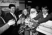 5,000,000th Passenger Through Dublin Airport. (T12).1989..22.12.1989..12.22.1989..22nd December 1989..The date,Friday,22nd December 1989 will be remembered as an historic day in Irish Aviation as Aer Rianta celebrated the 5millionth passenger to fly through Dublin Airport in one year. The Lucky passenger, Nicola Wynne, arrived at 10AM from Germany and was welcomed to Dublin Airport by General Manager,Tom Cullen... Picture shows Santa and Mr Terence McGowan,Delta Airlines sharing the champagne with Nicola Wynne after she was declared the 5millionth traveller of the year.