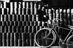 Bicycle and coal bricks outside house in hutong in Beijing China
