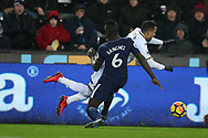 Davinson Sanchez of Tottenham Hotspur goes in hard and fouls Martin Olsson of Swansea city, and the Tottenham defender escapes a booking despite already on a yellow card earlier in the match. Premier league match, Swansea city v Tottenham Hotspur at the Liberty Stadium in Swansea, South Wales on Tuesday 2nd January 2018. <br /> pic by  Andrew Orchard, Andrew Orchard sports photography.