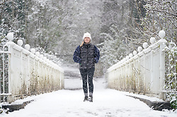 © Licensed to London News Pictures. 12/04/2021. Elstree, UK. A walker braves the snow on Reigate Hill in Surrey as early morning flurries hit the south. Photo credit: LNP