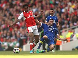 21 May 2017 London : Premier League - Arsenal v Everton :<br /> Alex Iwobi of Arsenal is tackled by Morgan Schneiderlin.<br /> Photo: Mark Leech